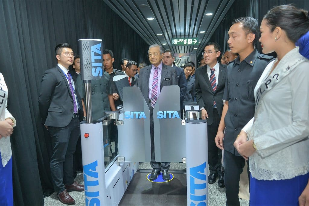 SITA's Smart Path biometric passenger processing technology at Kuala Lumpur International Airport being tested by Malaysian Prime Minister Tun Dr Mahathir Mohamad