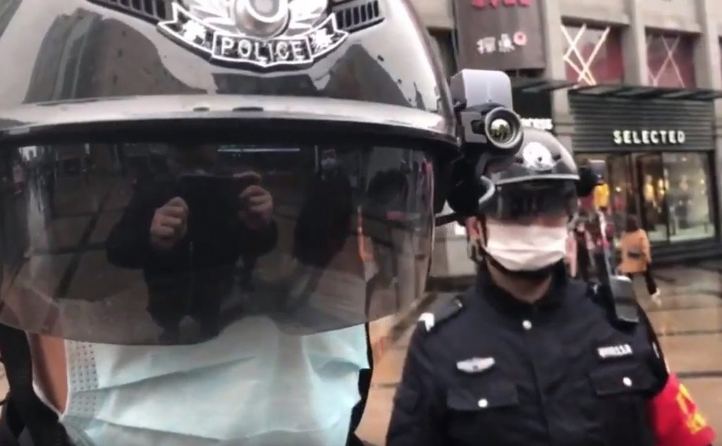 Biometric face-scanning helmets reading the temperatures of people in crowds in China